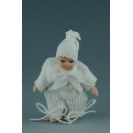 Kūdikis baltais drabužėliais