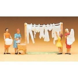 Women hanging laundry